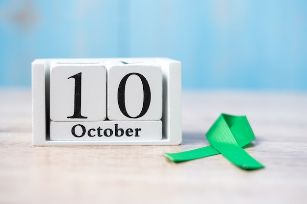 October 10 of white calendar with green ribbon. world mental health day
