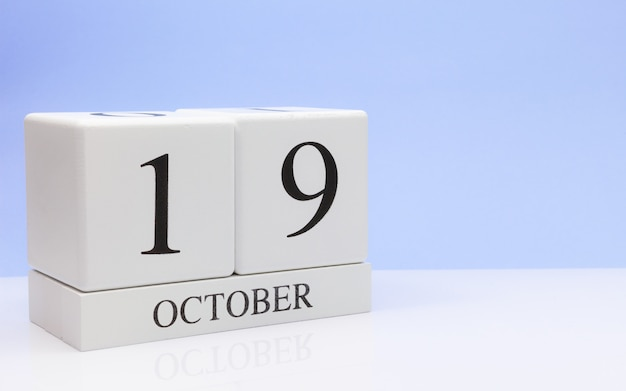 October 19st. day 19 of month, daily calendar on white table