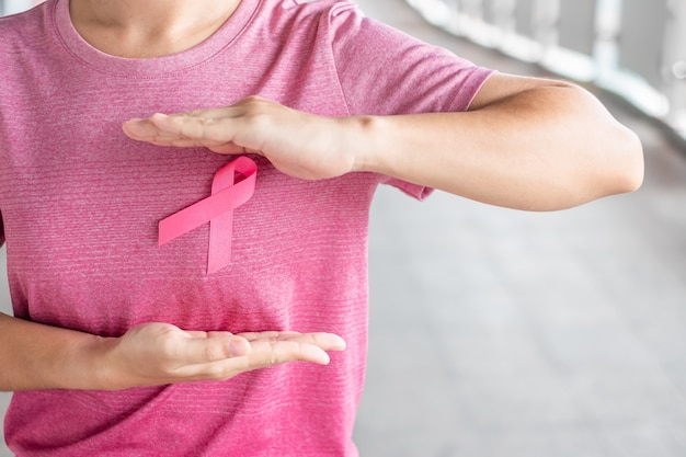 October breast cancer awareness month, woman in pink t- shirt with pink ribbon for supporting people living and illness. healthcare, international women day and world cancer day concept