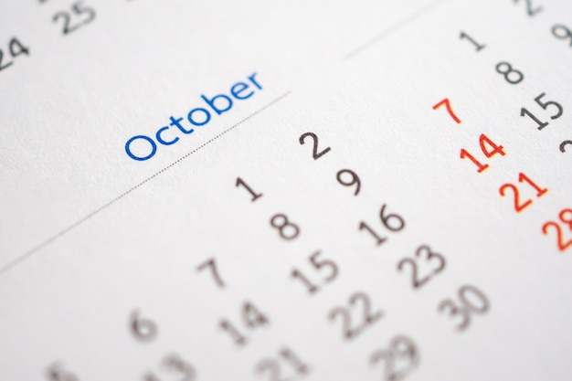 October calendar page with months and dates business planning