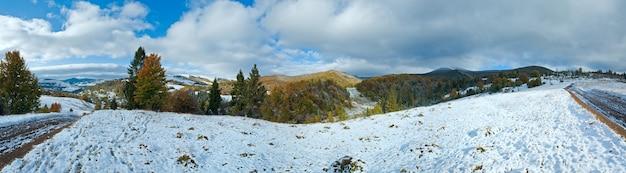 Октябрь панорама гор карпаты с первым зимним снегом на грязной дороге. составное изображение из четырех кадров.