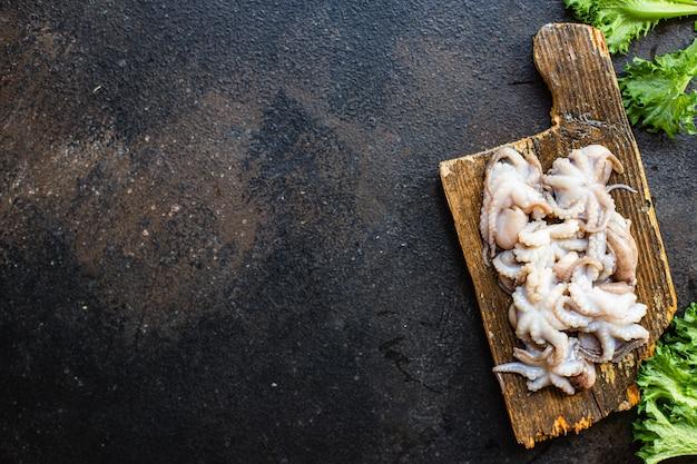 Осьминог сырые морепродукты свежие детские размер