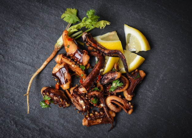 Octopus salad with lemon herbs and spices tentacles squid grilled hot and spicy chilli sauce seafood