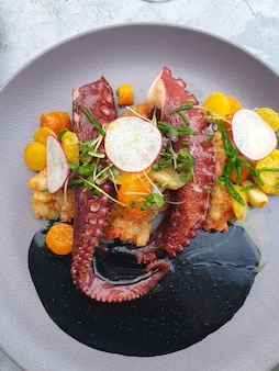Octopus with vegetables with cuttlefish ink
