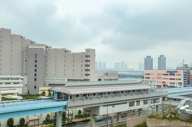 Odaiba monorail trains stop at a station to send and pick up passengers in odaiba, japan