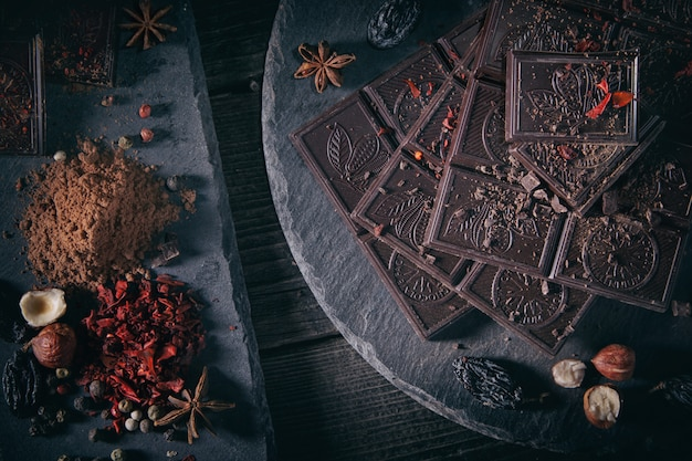 Odessa, ukraine. millennium chocolate bar rostik, chocolate, cocoa, spices and spices cinnamon, red pepper, on a dark background.