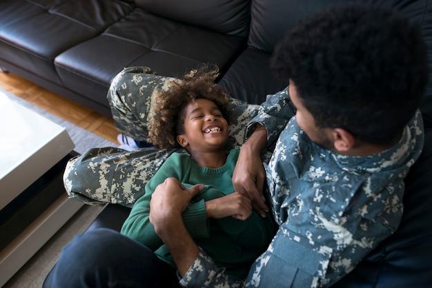 An off duty military man enjoying family moments
