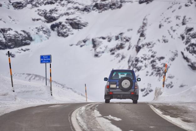 An off-road car transits the bernina pass in switzerland