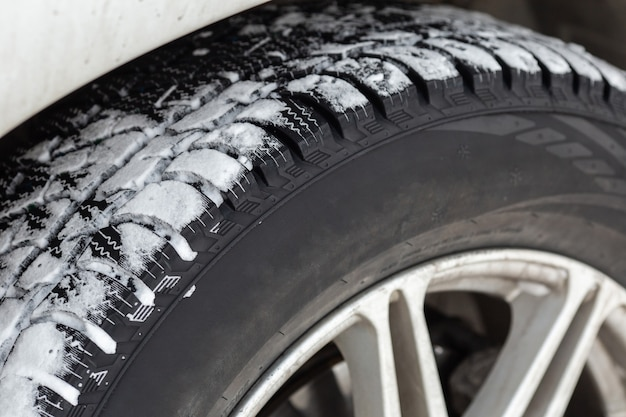 Off road winter tire packed with snow in deep snow. closeup. outdoor