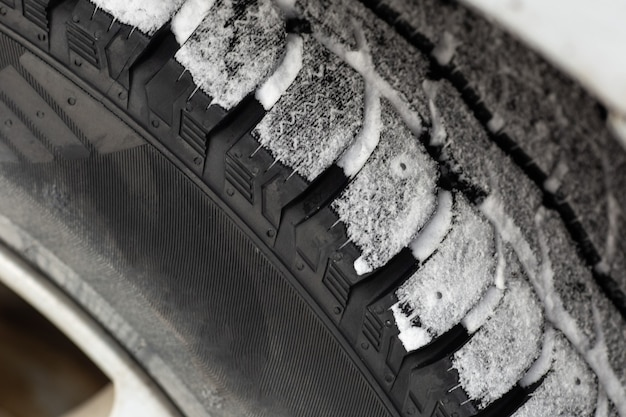 Off road winter tire packed with snow in deep snow.