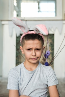 Offended boy in bunny ears