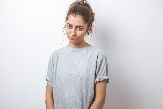 Offended girl on a white background.
