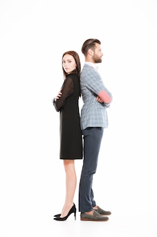 Offended loving couple standing isolated