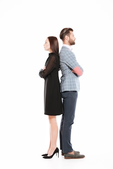 Offended serious loving couple standing isolated