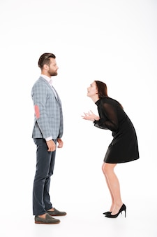 Offended young loving couple swear isolated
