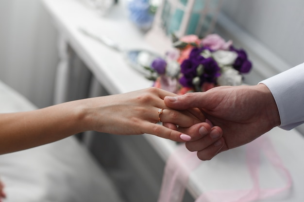 Offer of hand and heart. a man gives a hand to a woman. wedding proposal. the groom gives hand to the bride. romantic moment close up . romantic date