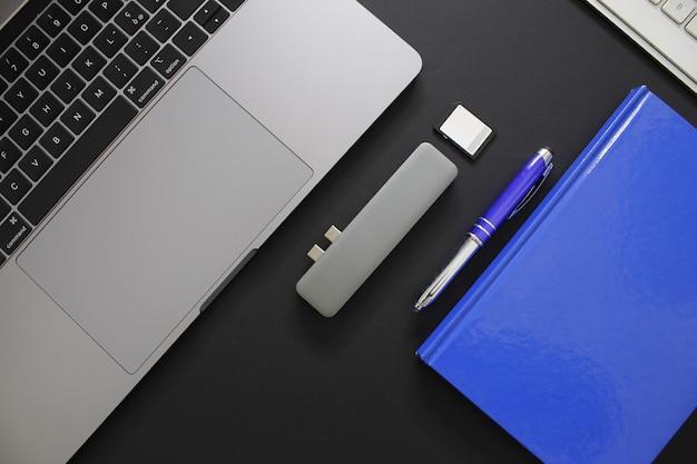 Office black workspace on black background for designer.
