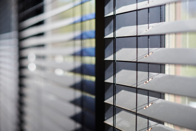 Office blinds. modern wooden jalousie. office meeting room lighting range control.