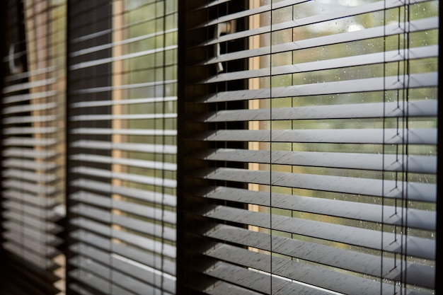 Office blinds. modern wooden jalousie. office meeting room lighting range control.