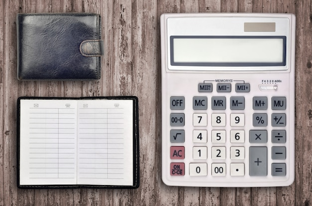 Office composition with calculator, address book and black purse