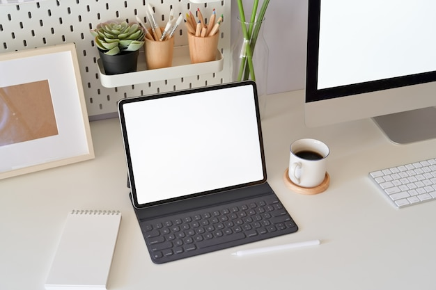 Office desk scenery with mockup blank screen laptop computer. workspace minimal