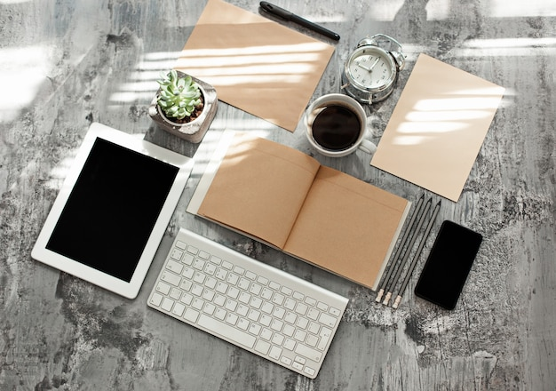 Office desk table with computer, supplies and mobile phone