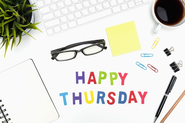 Office desk table with happy thursday word