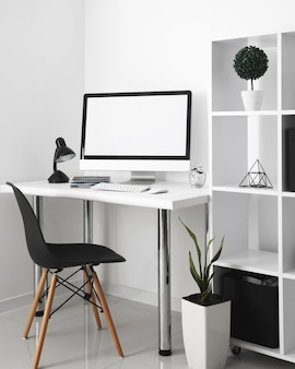 Office desk with computer and desk chair