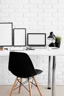 Office desk with laptop and chair