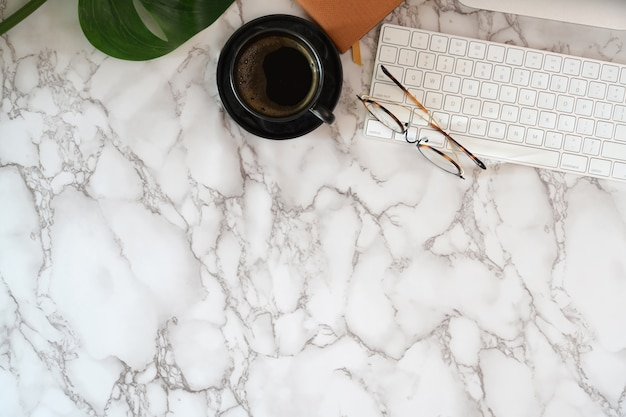 Office desk with office supplies on marble desk top table