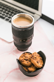 Office desktop with a coffee cup and cookies