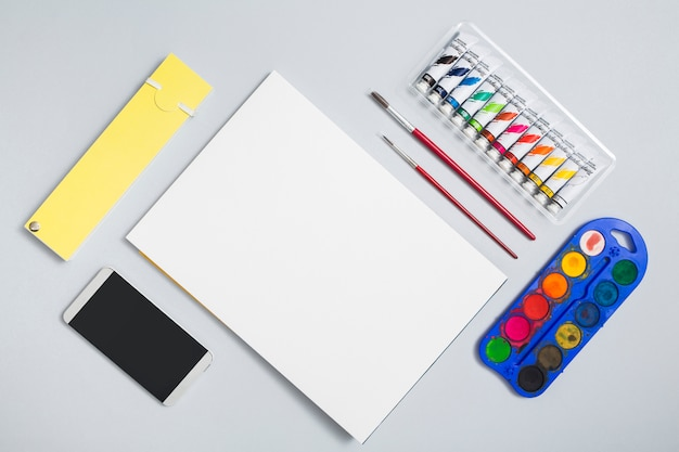 Office desktop with drawing materials