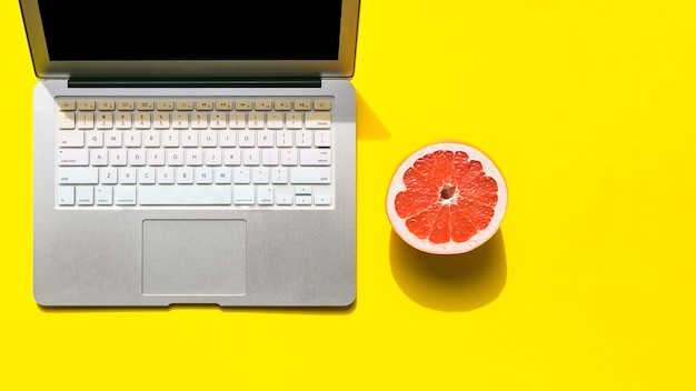 Office desktop with a laptop and fruit