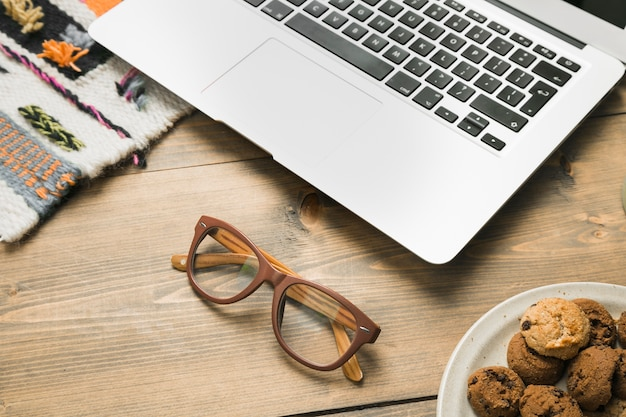 Office desktop with a laptop and a glasses
