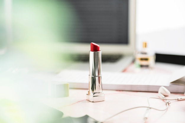 Office desktop with a lipstick