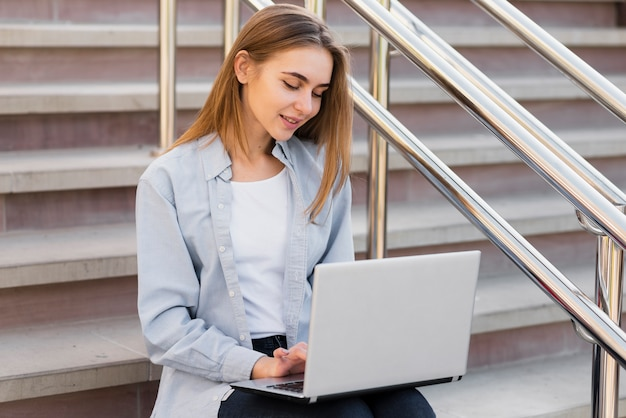 Office dressed woman working on laptop