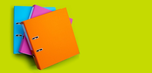 Office folders on green surface with copy space. top view
