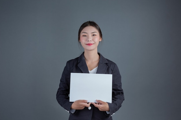 Office girl holding a white blank board
