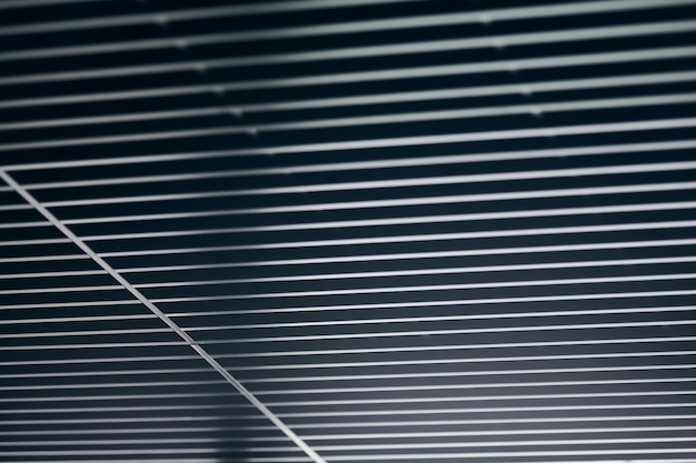 Office grille ceiling. modern black metal grille ceiling, suspended covering. abstract design texture.