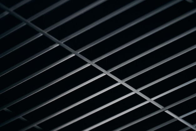 Office grille ceiling. modern black metal grille ceiling, suspended covering. abstract texture.