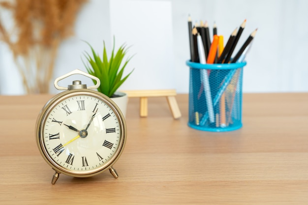 Office interior details with alarm clock and stationery items