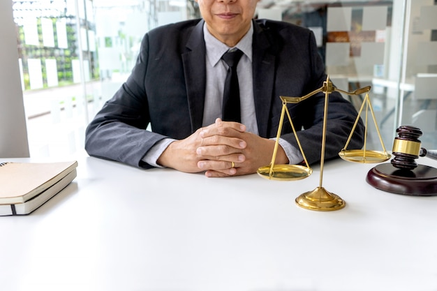In the office of judge or lawyer, there are balance and gavel