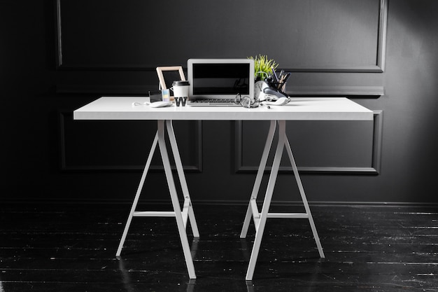 Office leather desk table with computer, supplies