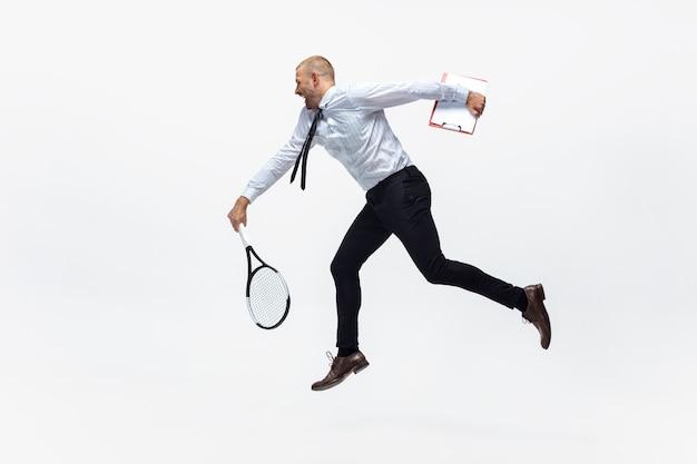 Office man plays tennis on white, sportsman