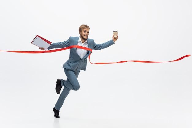 Office man running, jogging on white