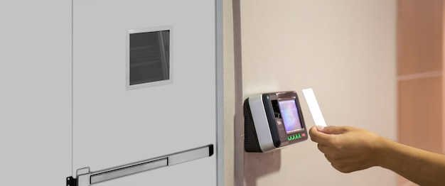 Office man using the id card to scan at the access control.