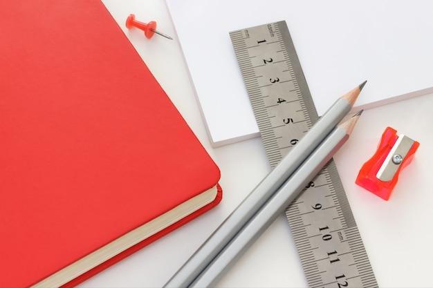 Office set with graphite pencils, ruler, notebook, paper and sharpener