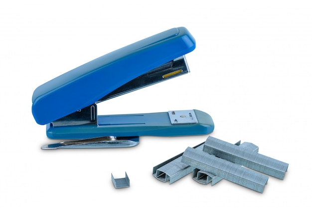 Office stationary blue stapler with pile of staples isolated
