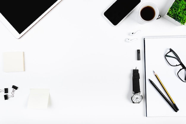 Office stationery and gadgets on workplace