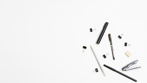 Office stationery randomly scattered on white background, flat lay. copyspace